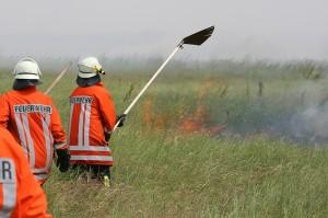 Feuerwehrleute bei der Brandbekämpfung  © Heckroth/Mellumrat e.V.